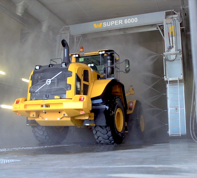 Tractor being washed in a touchless wash system.