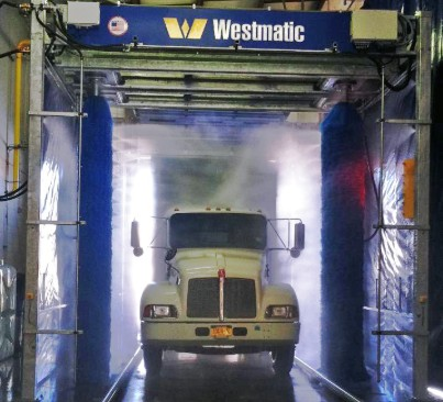Hybrid Drive-Through Vehicle Wash System